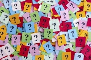 A mass of colourful question marks piled on top of one another
