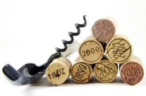Corkscrew and corks with year stamp as pyramid